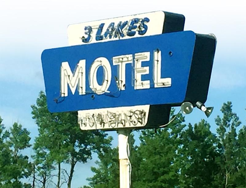 three lakes motel sign in michigame, mi